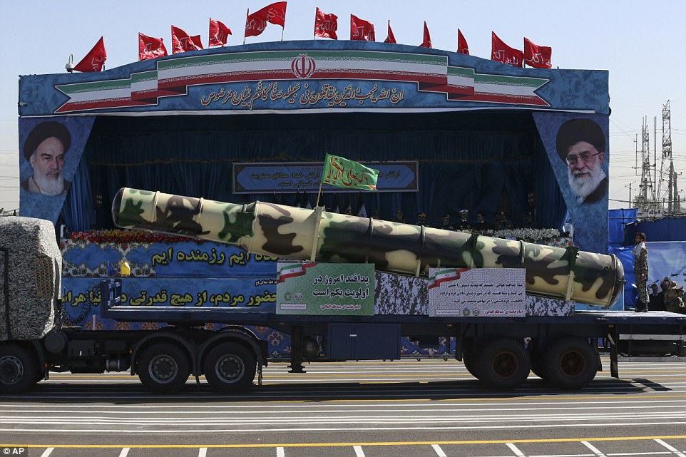 A Russian-made S-200 air defense system is driven past portraits of the late revolutionary founder Ayatollah Khomeini, left, and Supreme Leader Ayatollah Ali Khamenei, during a parade marking National Army Day, in front of Khomeini's mausoleum, just outside Tehran