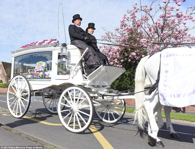 A horse-drawn carriage, pictured, brought the coffin to St Julie's Church in Eccleston, St Helens
