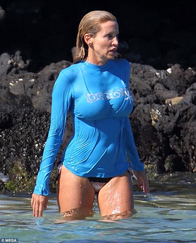 Into the blue: She wore a tight blue rash-guard top over her bikini