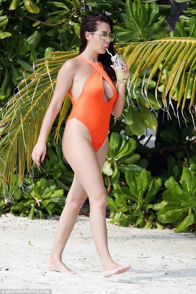 Extended holiday: The sizzling star has been lapping up the sun for nearly three weeks now