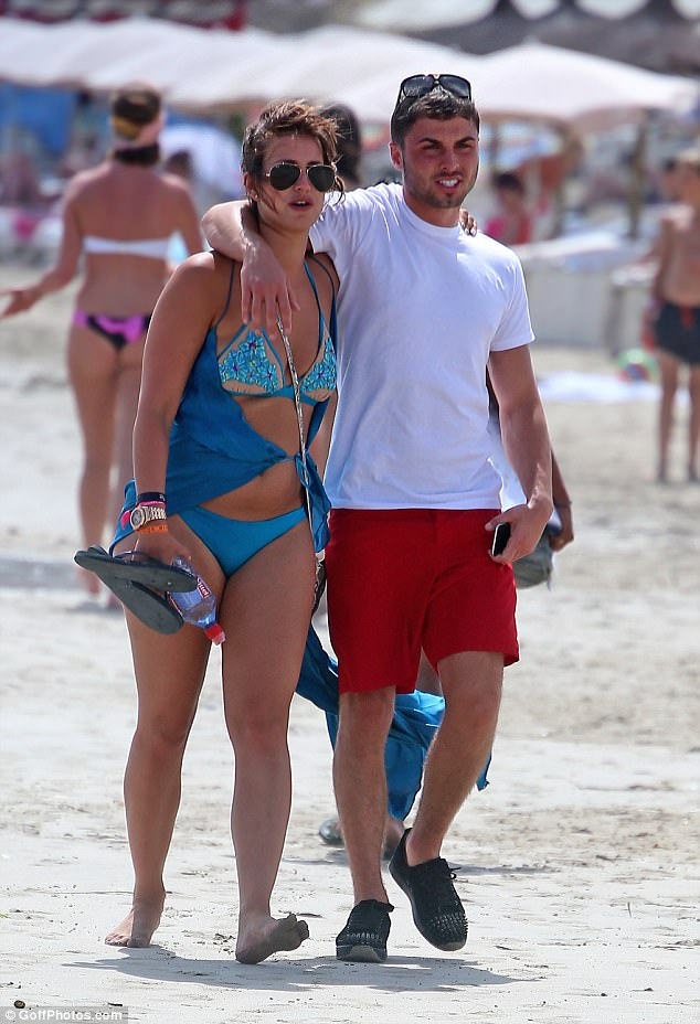 Happier times: Pictures have emerged of Ferne McCann and Arthur Collins looking loved-up during a holiday to Ibiza in August 2016 as the former TOWIE star urges her boyfriend  to hand himself into police in connection with a nightclub acid attack