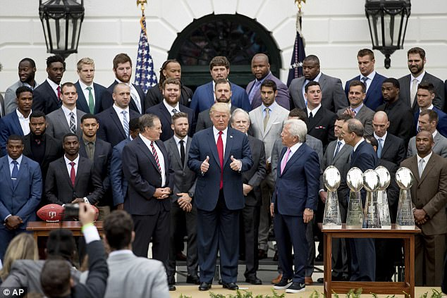 The members of the New England Patriots who did make the trip to the White House are pictured with the president on Wednesday