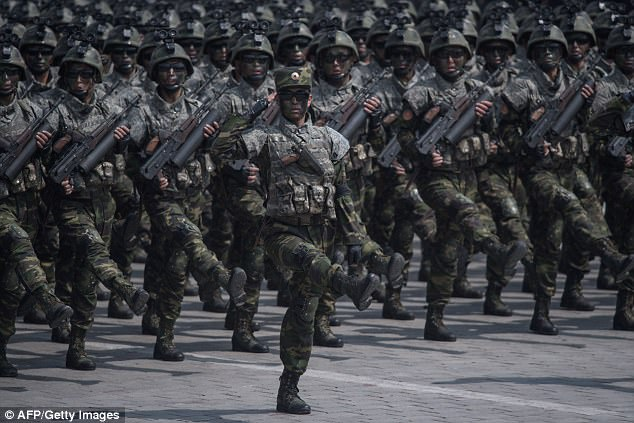 Thousands of goose-stepping troops paraded through Pyongyang in a show of strength on Saturday