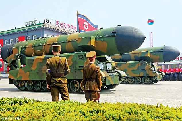 Chilling: An enormous missile drives past troops during the Day of the Sun military parade on Saturday