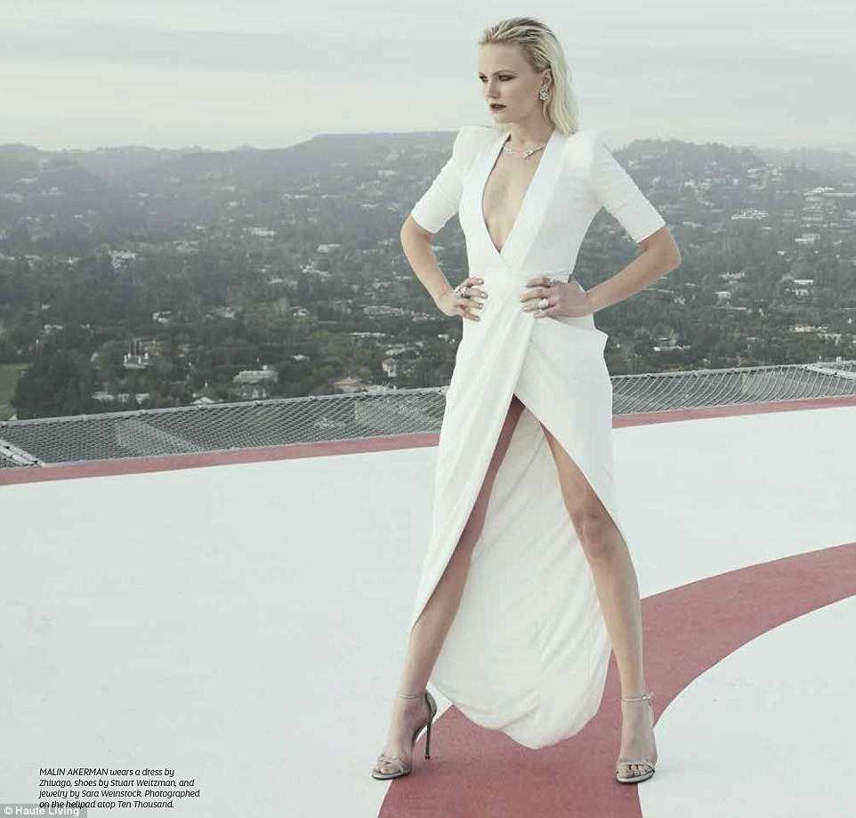 Legs: In a dress by Zhivago, Malin let her gams shine as she stood on top of a building