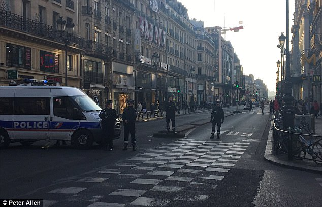 Police closed off the busy street in the heart of the city as they tried to deal with 'suspicious items'