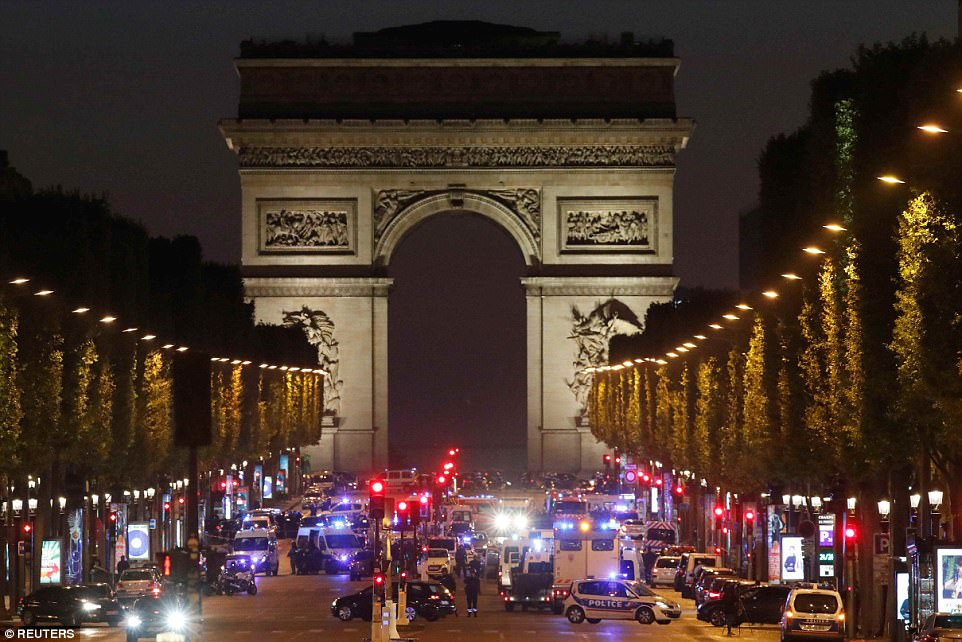 A French police officer has been shot dead on the Champs Elysees in Paris (pictured) - just as presidential candidates took part in a TV debate nearby