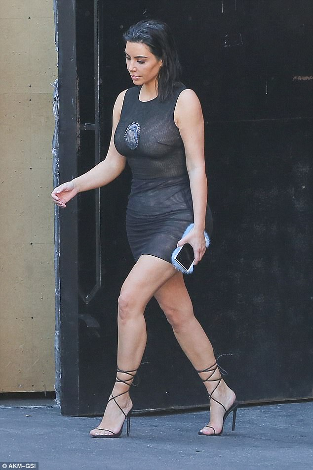 Beauty: Kim Kardashian stepped out in a little black dress after leaving a photo shoot in LA on Thursday