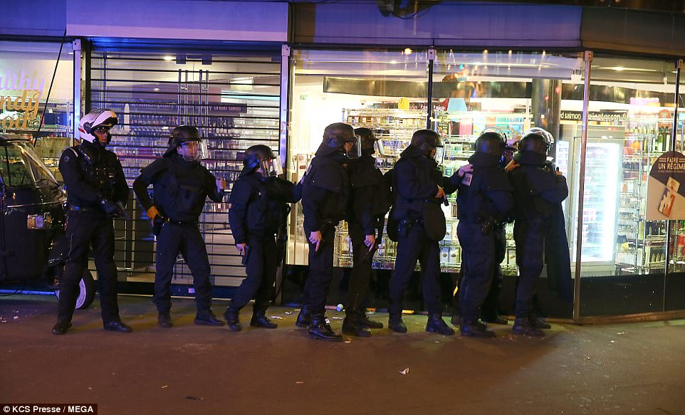 Armed police outside a shop in central Paris after an ISIS gunman killed a traffic officer and injured three other people