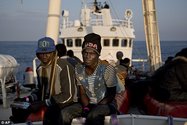 Earlier this month, Nigerian asylum seeker Yakubu Yahya, 17 (centre), was pictured onboard of the Golfo Azurro vessel one day after being rescued by members of Proactiva Open Arms NGO
