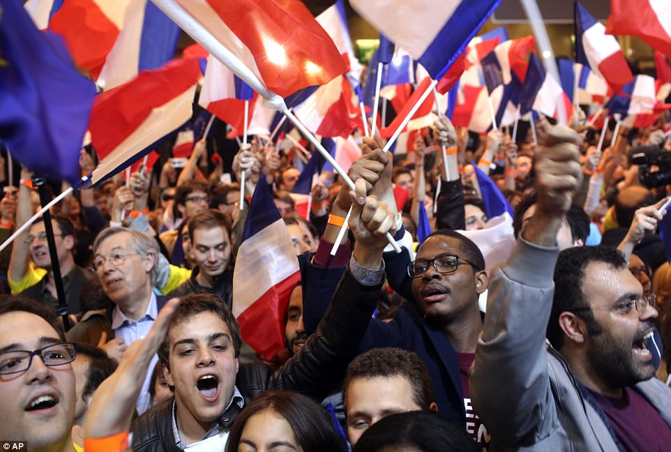Supporters of French centrist candidate Macron were also seen cheering in delight at the results and waving the French flag