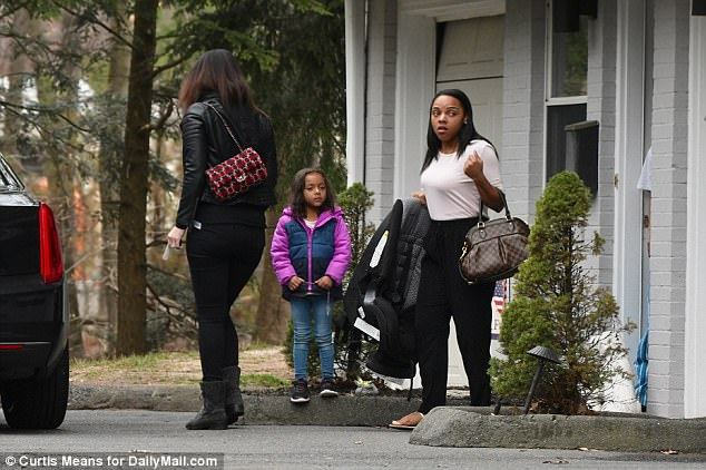 Shayanna Jenkins-Hernandez, 27, looked drawn as she and daughter Avielle stepped out just before sunset on Wednesday, the day after her life partner and fiance, Aaron Hernandez, committed suicide in jail