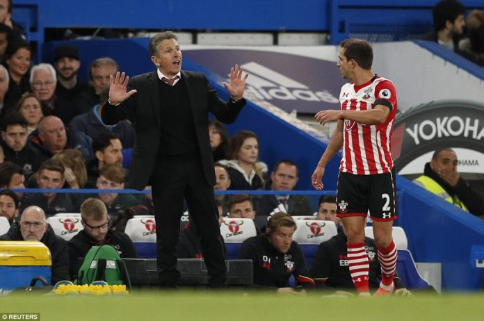 Southampton manager Claude Puel issues instructions to defender Cedric Soares
