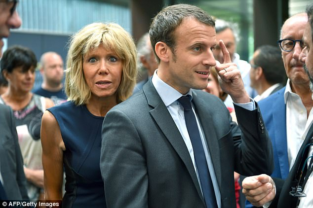 By his side: Despite the early controversy around their relationship, Brigitte Trogneux-Macron has been at his side throughout his career in politics. Pictured: Emmanuel Macron as French economy and industry minister in August 2016
