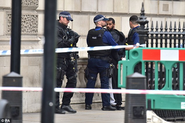 A suspect is being held in Whitehall after reports he arrived at the scene with a bag of knives