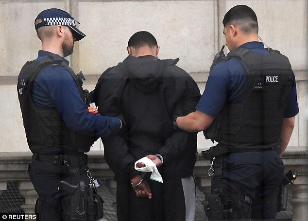 The man was tackled on a traffic island before being held against the wall of the Treasury