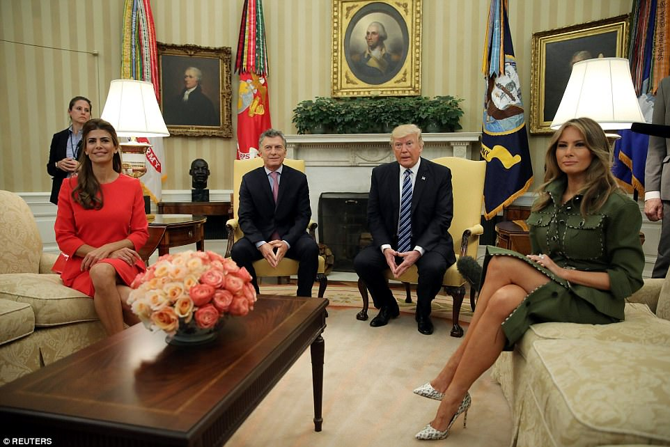 Both first ladies sat posed with their legs crossed and their hands folded in their laps in the Oval Office