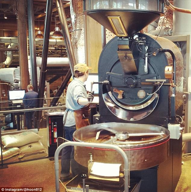 Artisan:The Roastery, described by Starbucks as a 'fully sensorial coffee environment', will serve  coffee that will be roasted, brewed and packaged on-site (pictured is the Seattle shop)