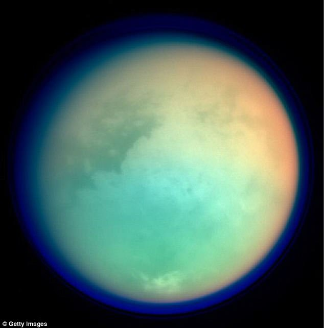 This NASA image shows Saturn's moon, Titan, in ultraviolet and infrared wavelengths. The Cassini spacecraft took the image while on its mission to gather information on Saturn, its rings, atmosphere and moons. The different colors represent various atmospheric content on Titan