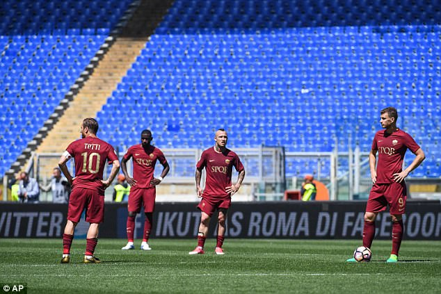 Roma players were left dejected after squandering the chance to make ground on Juventus