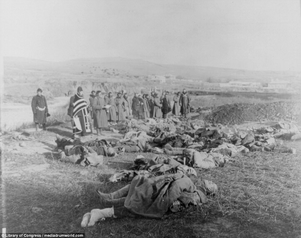 A priest and soldiers are pictured praying over the bodies of Russian soldiers who would be buried on a hill in Port Arthur in Manchuria. Both Russia and Japan lost tens of thousands of servicemen during the conflict between 1904 and 1905