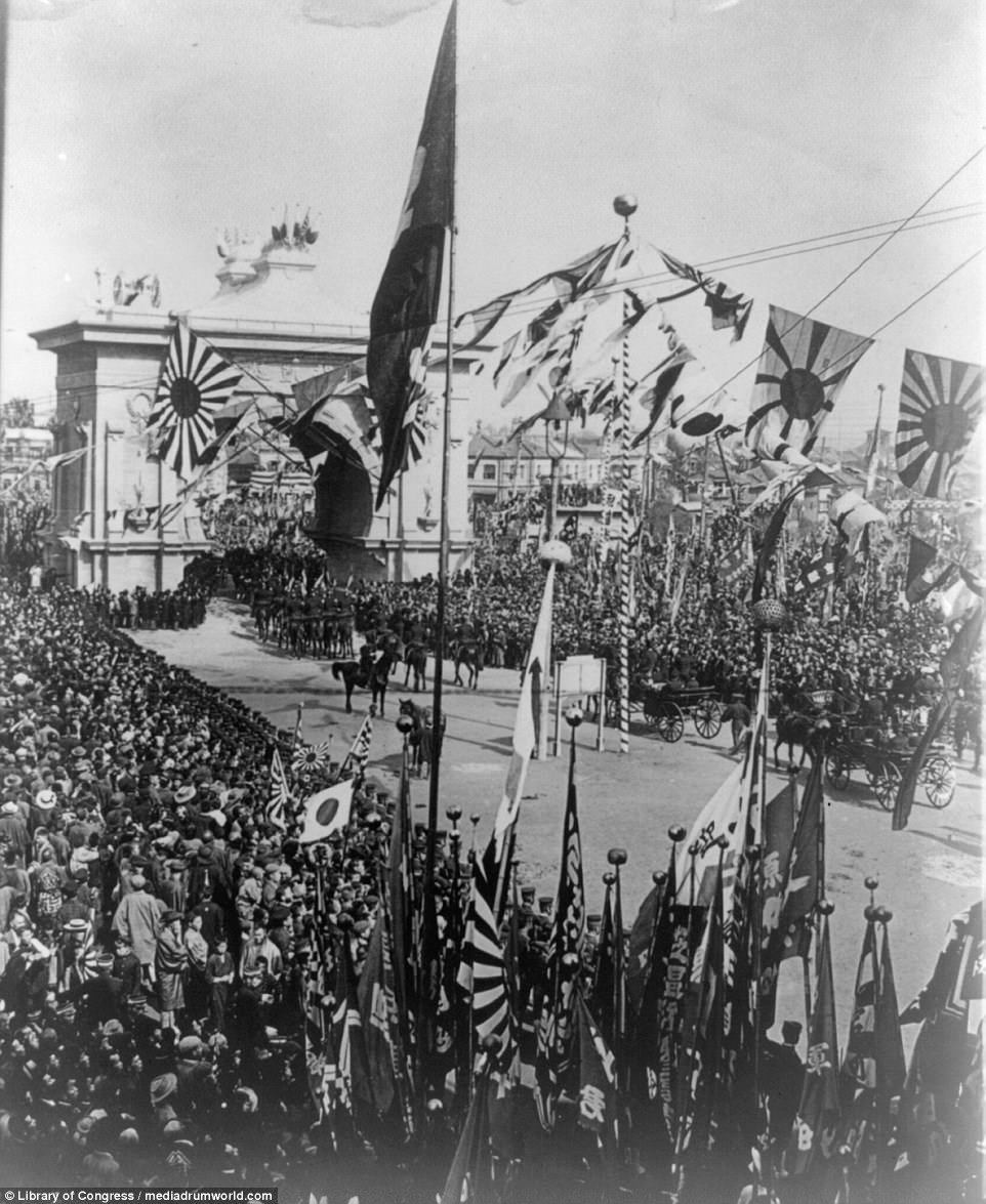 Crowds are pictured lining the streets to honour a procession of carriages carrying Japanese Admiral T¿g¿ Heihachir¿, hailed as one of the country's greatest ever naval chiefs. Peace was sealed with the Treaty of Portsmouth, signed in Maine in the US. President Theodore Roosevelt would win the Nobel Peace Prize for his role in bringing the treaty to fruition