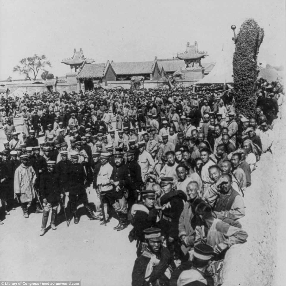 A large crowd of Japanese soldiers are pictured in Manchuria during a devastating conflict which saw Russia defeated, losing almost all of its Pacific and Baltic fleets