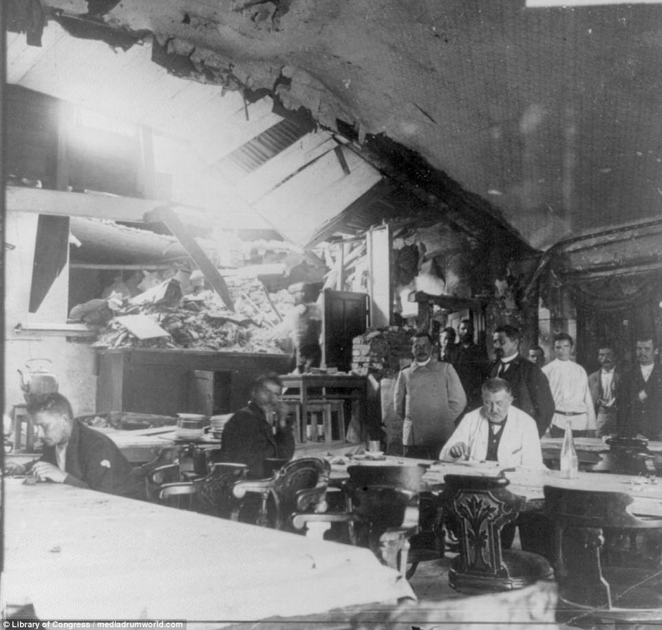 Russian troops and officials dine in a restaurant which had been heavily damaged by Japanese shells during the conflict, in which both sides battled for influence in the crucial shipping region