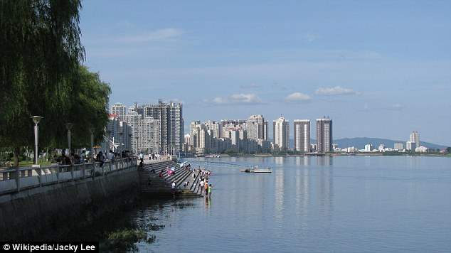 The city of Dandong (pictured) on the border with North Korea has reportedly been told to find the Korean-Chinese interpreters to work at 10 departments in the town