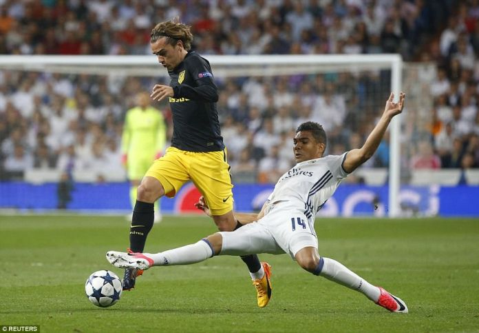 Griezmann tries to lead Atletico forward, but is stopped by a stretching tackle from Casemiro, who gets a toe to the ball