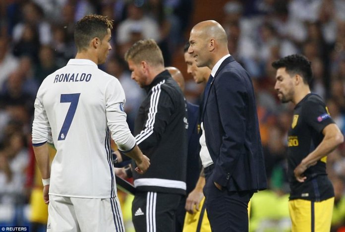 Real Madrid's talisman takes advantage of a break in play to discuss tactics and share a smile with coach Zinedine Zidane