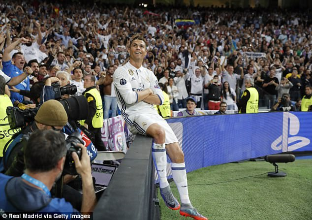 Cristiano Ronaldo sits on the advertising hoardings to soak up the Bernabeu's adulation