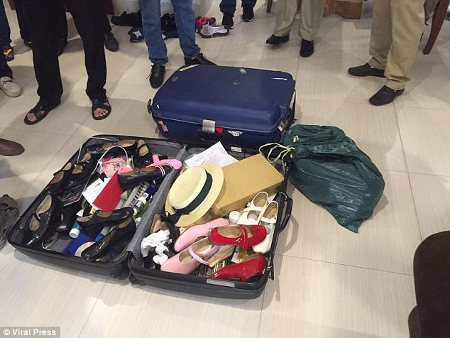 British doctor Clive Cressy has been arrested for paying girls as young as 12 for sex in Cambodia. Police found he had a suitcase (pictured) packed with children's clothes and Barbie dolls, it has emerged