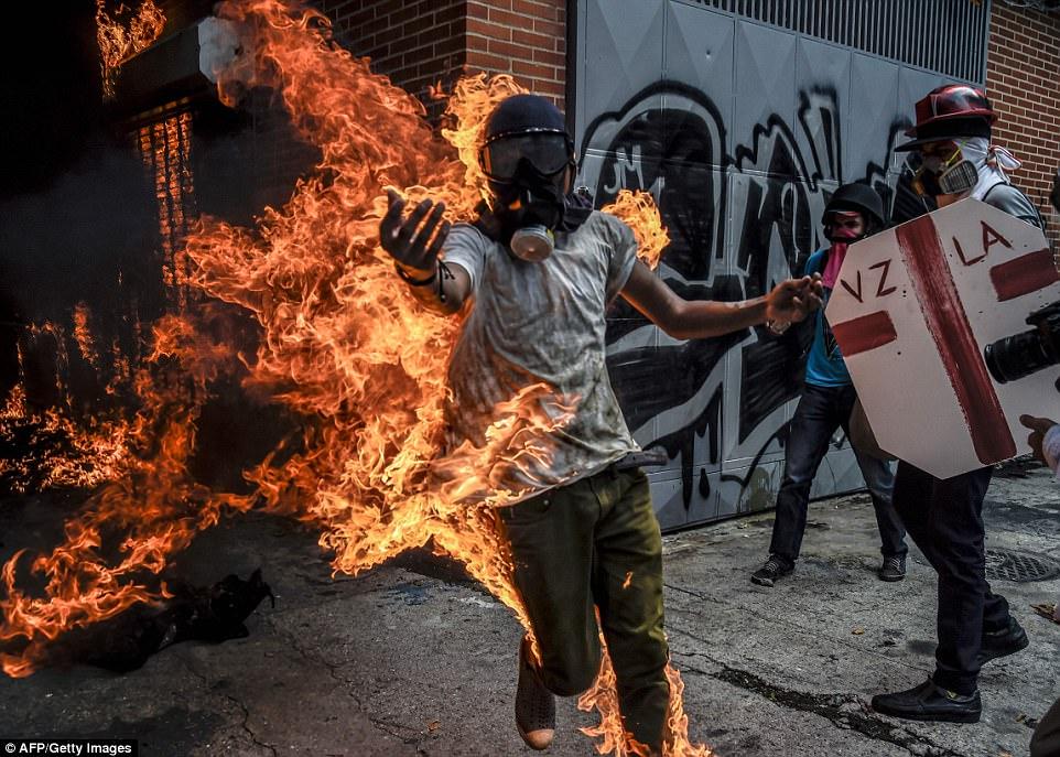 Image result for venezuela in flames
