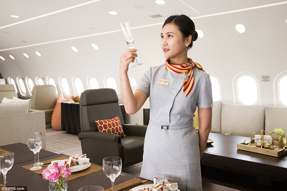 Quality control: An immaculately dressed air hostess casts a myopic eye over the presentation of the cutlery