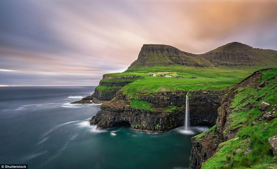 In full flow: The Faroe islands boasts dozens of waterfalls. The stunning Mulafossur Waterfall, above, is located by the remote community of Gásadalur on Vágar island