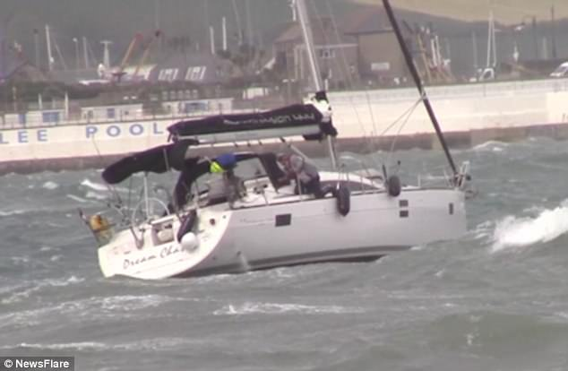 A yachtsman was also filmed battling against the elements during a heavy storm