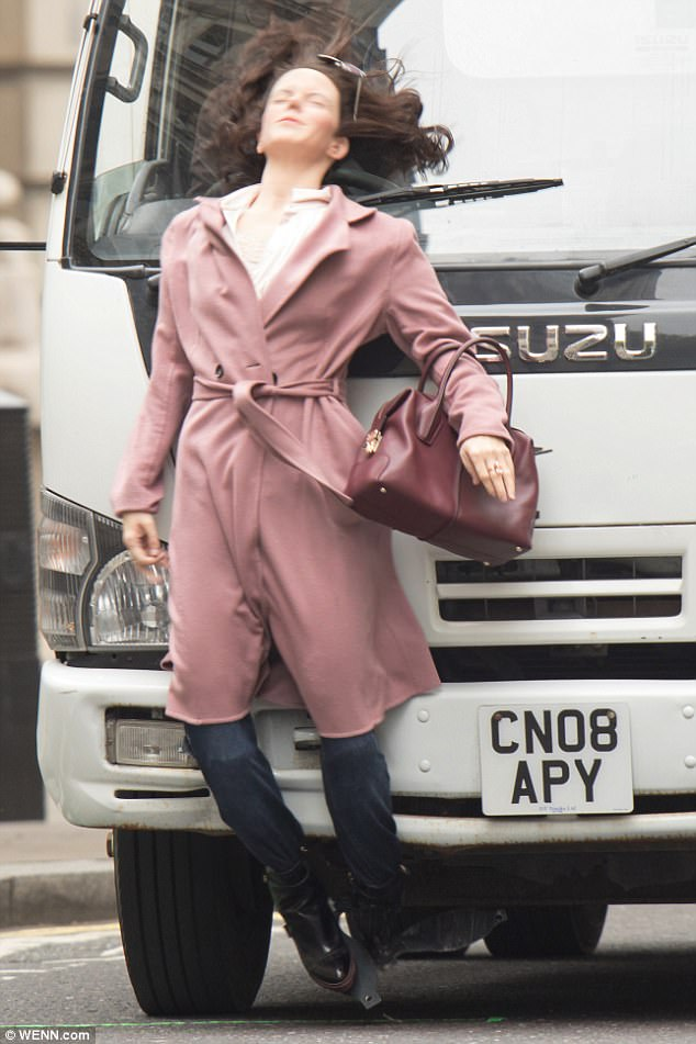 Terrifying stunt: A plastic model of Mary-Louise Parker was hit by a lorry and smashed on the tarmac during filming for spy drama Red Sparrow in London on Saturday