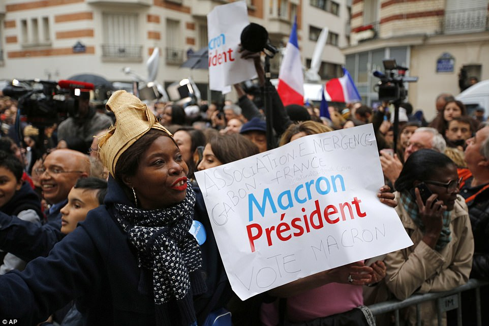 Supporters of French independent centrist presidential candidate, Emmanuel Macron, reacted outside his campaign headquarters in Paris on Sunday