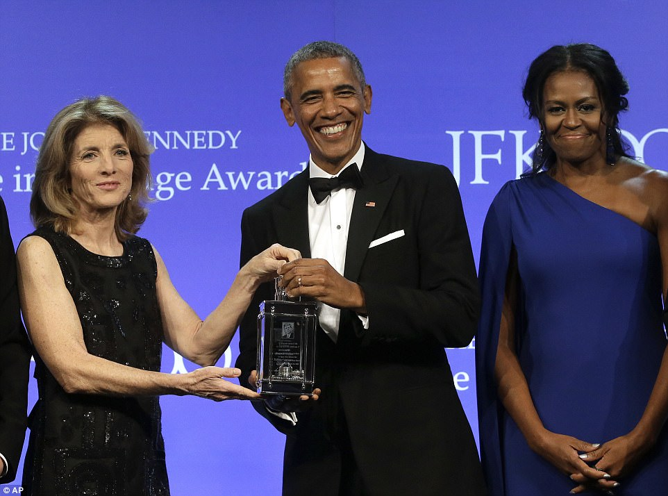 The former president was joined by wife Michelle as he was presented the political courage award by Caroline Kennedy in Boston on Sunday night