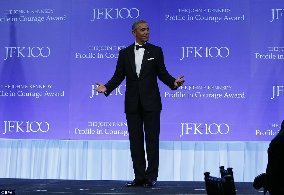 Obama was careful not to mention Donald Trump by name in Boston on Sunday night as he referenced the current administration's efforts to dismantle much of his signature health care law