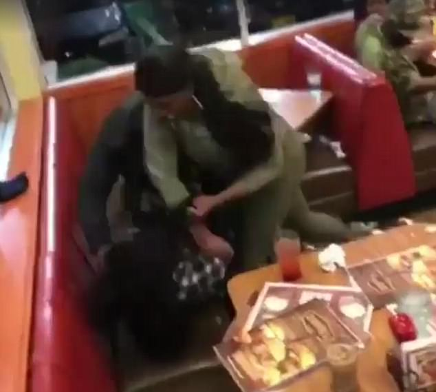 Footage of the fight in the Denny's restaurant in Albany, New York at 4.20am on Sunday showed multiple people punching and kicking each other in front of shocked customers