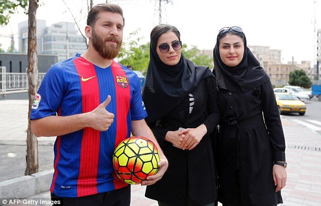 The 25-year-old is constantly turning heads, pictured here posing for a photograph with two women
