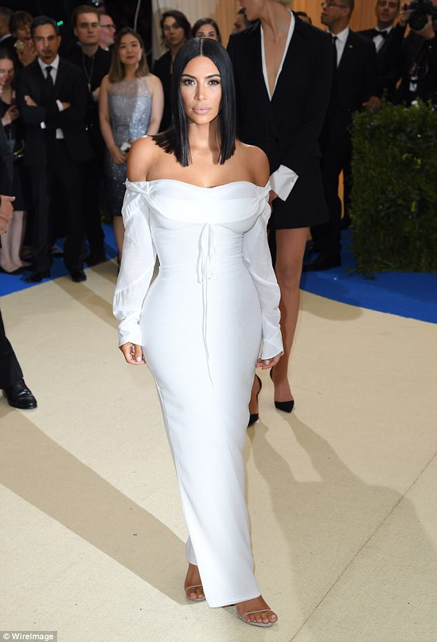 Another off-the-shoulder look: Here Kim is seen at the Met Gala in NYC last week