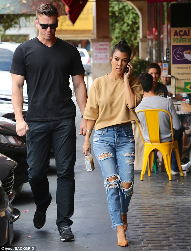 Scott won't like this: Kourtney's bodyguard was quite the hunky young man