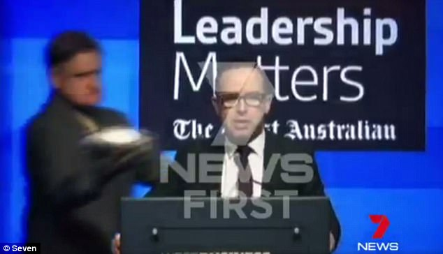 Qantas CEO Alan Joyce  (right) was attacked by an elderly man wielding a lemon meringue pie (left) on Tuesday morning as he addressed business leaders in Perth