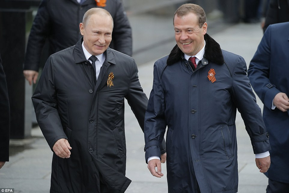 Amid heightened security both President Vladimir Putin (left) and Prime Minister Dmitry Medvedev (right) were there to celebrate the 72nd anniversary of the victory over Nazi Germany
