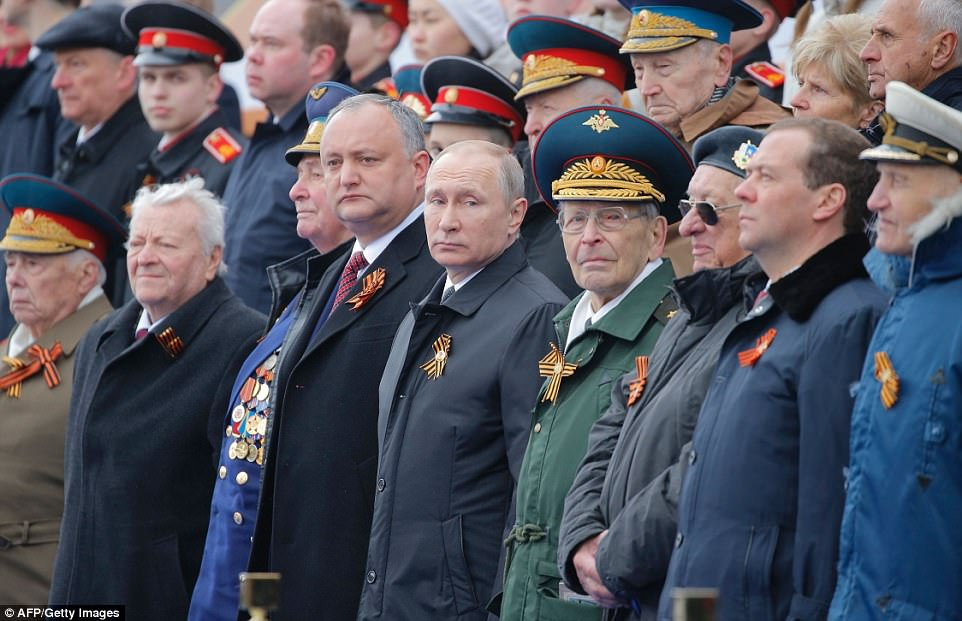 Russian President Vladimir Putin joined other dignitaries as he watched the massive parade this morning