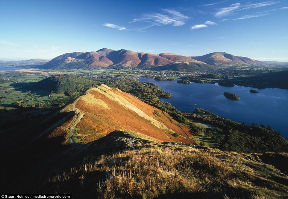 To the summit and beyond: Holmes hiked to the top of Cat Bells in Cumbria to get this shot of Skiddaw in the distance. It is the sixth-highest summit in England at 3,054 feet