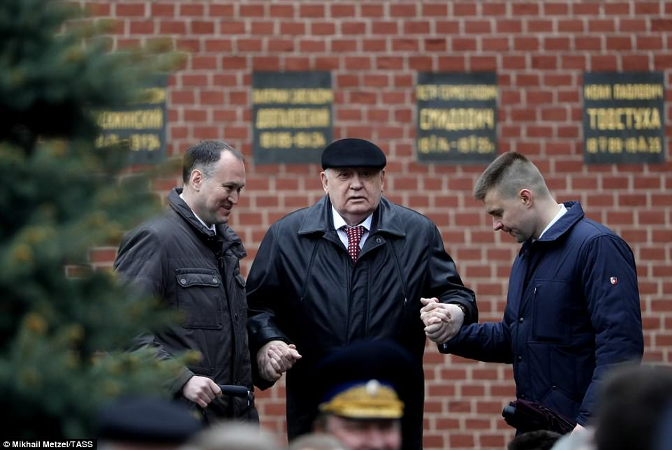 Former president of the USSR Mikhail Gorbachev (centre) was given a helping hand as he attended the event today